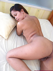 Petite Asian ladyboy naked on her bed and spreading