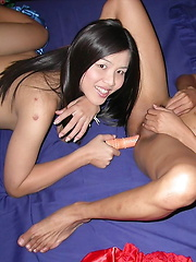 Two kathoys using a sex toy to pleasure their back orifice