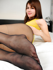 Asian femboy showing her cock through her silky pantyhose