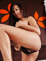 This Oriental young tranny has a very hard pecker