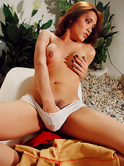 Very Hot Asian Shemale takes off her Leather Pants and Shows her nice Cock